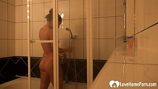 Amazing brunette lets her man record her shower